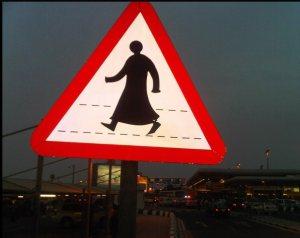 men in thobe crossing